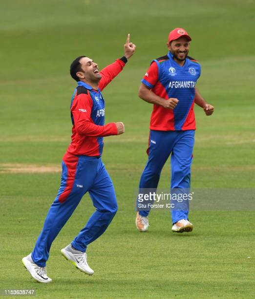 Afghanistan bowler Mohammad Nabi celebrates with team mates after taking the wicket of Kusal Mendis during the Group Stage match of the ICC Cricket...