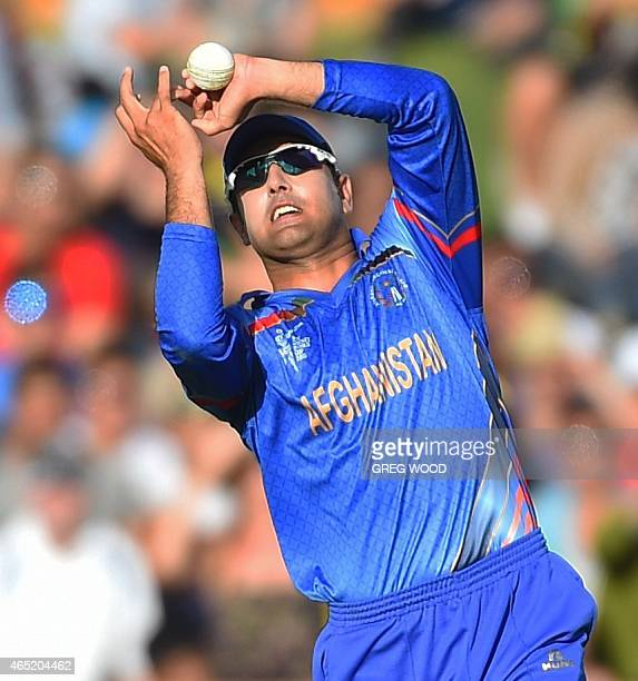 Afghanistan captain Mohammad Nabi takes a catch to dismiss Australia's David Warner for 178 runs during the 2015 Cricket World Cup Pool A match...