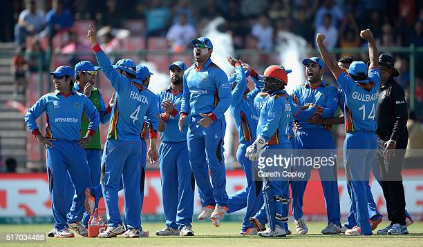 Afghanistan celebrate after running out Joe Root of England during the ICC World Twenty20 India 2016 Group 1 match between England and Afghanistan at...