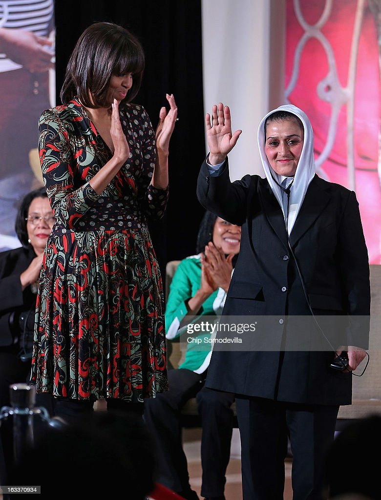 Afghanistan Counter Narcotics Police First Sergeant Malalai Bahaduri (R) acknowledges applause from U.S. first lady Michelle Obama and others before receiving the International Women of Courage Award at the State Department March 8, 2013 in Washington, DC. In celebration of the 102nd International Women's Day, the State Department honored nine women from around the world with the International Women of Courage Award, including the 23-year-old Indian woman known only as 'Nirbhaya,' who died from injuries she received after being gang raped by six men last December in Delhi.