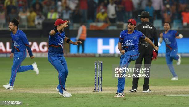 Afghanistan Cricket captain Asghar Afghan celebrates with teammate after the match during the one day international Asia Cup cricket match between...