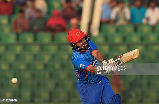 Afghanistan cricketer Karim Sadiq plays a shot during The Asia Cup T20 qualifying match Afghanistan and United Arab Emirates at Khan Shaheb Osman Ali...