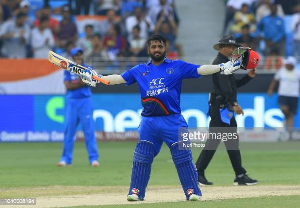 Afghanistan cricketer Mohammad Shahzad celebrates after scoring 100 runs during the Asia Cup 2018 cricket match between India and Afghanistan at...