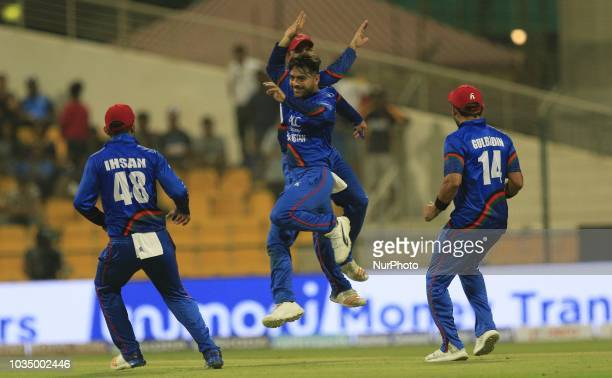 Afghanistan cricketers Rashid Khan and his team mates celebrates after taking a wicket during the 3rd cricket match of Asia Cup 2018 between Sri...