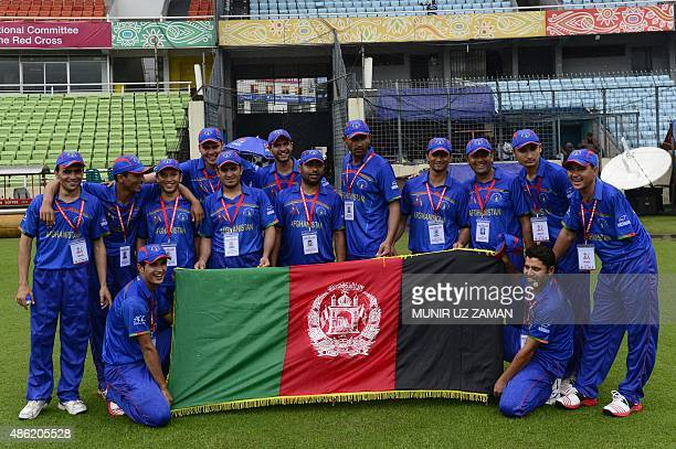 Afghanistan disable cricket team pose for a photo in ShereBangla National Cricket Stadium in Dhaka on September 2 2015 Afghanistan England India...