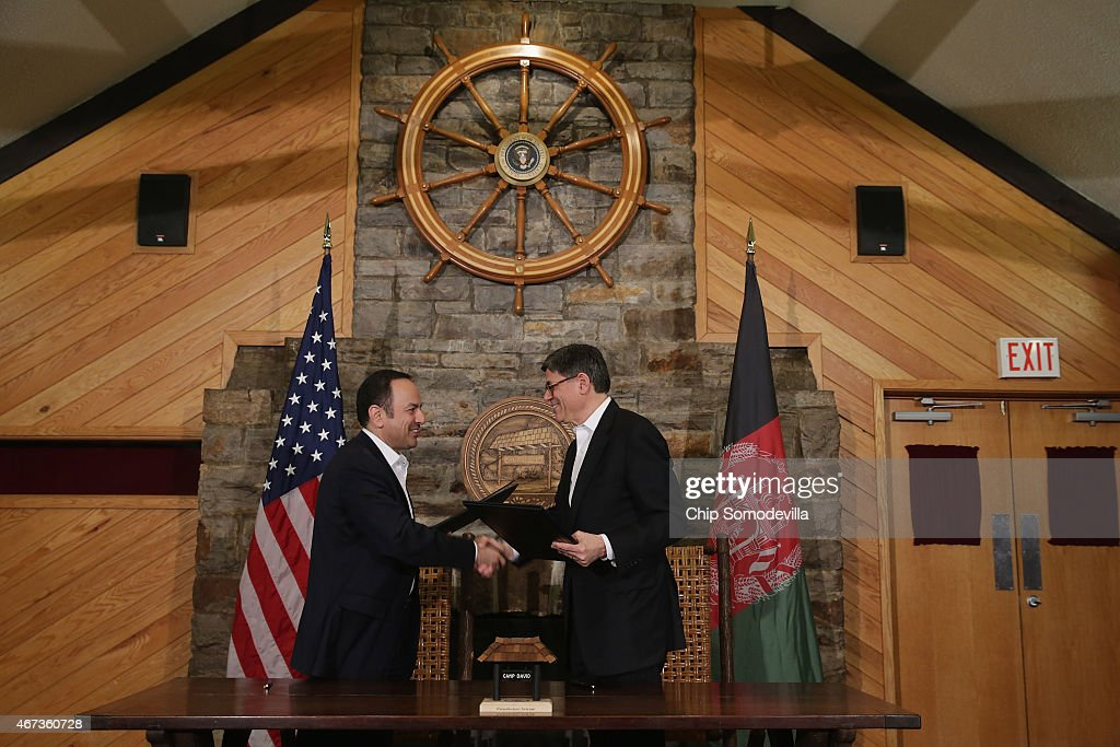 Afghanistan Finance Minister Eklil Hakimi and U.S. Treasury Secretary Jacob Lew shake hands after signing a memorandum of understanding during talks at Camp David March 23, 2015 in Camp David, Maryland. The MoU solidfies American support for a financial program that will set Afghanistan on a path toward stability and independence.