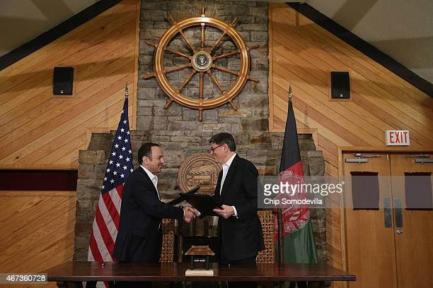 Afghanistan Finance Minister Eklil Hakimi and US Treasury Secretary Jacob Lew shake hands after signing a memorandum of understanding during talks at...