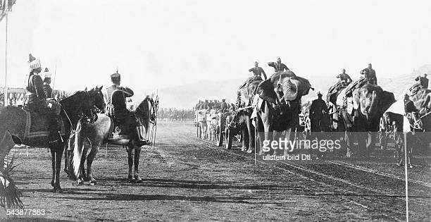Afghanistan, history: The emir of Afghhanistan Habibullah Khan taking the salute of his troopsAn elefant drawn artillery unit.Kabul 1910 No further...