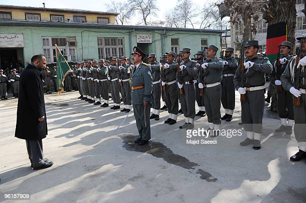 Afghanistan Interior Minister Mohammad Hanif Atmar arrives at a thanksgiving ceremony for Afghan policemen who fought against Taliban fighters during...