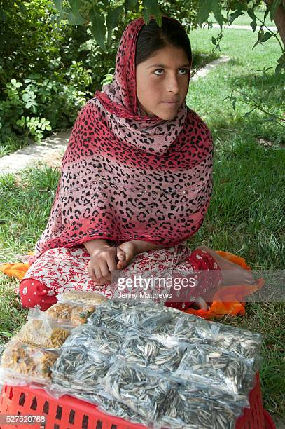Afghanistan Kabul BagheBabur gardens Hanifa selling sunflower seeds and bombay mix