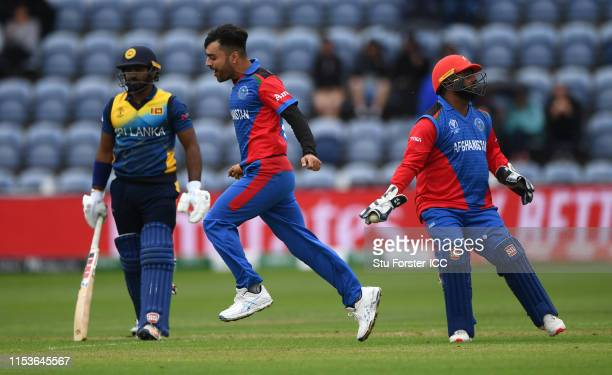 Afghanistan leg spin bowler Rashid Khan celebrates after dismissing Sri Lanka batsman Kusal Perera during the Group Stage match of the ICC Cricket...