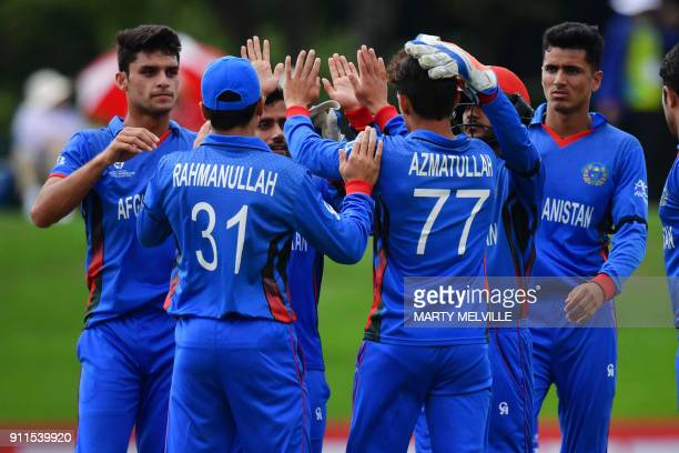 Afghanistan players celebrate Australia's Max Bryant being caught during the U19 semifinal cricket World Cup match between Australia and Afghanistan...