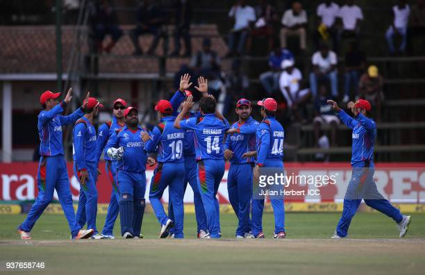 Afghanistan players celebrate the wicket of Evin Lewis of The West Indies during The ICC Cricket World Cup Qualifier Final between The West Indies...