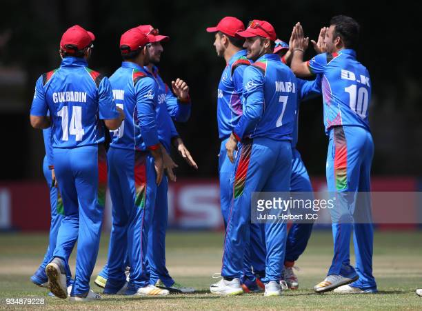 Afghanistan players celebrate the wicket of Ghulam Shabir of The UAE during The Cricket World Cup Qualifier between The UAE and Afghanistan at The...