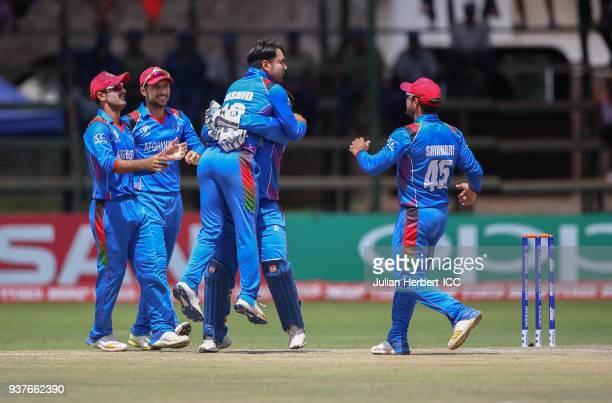 Afghanistan players celebrate the wicket of Shai Hope of The West Indies during The ICC Cricket World Cup Qualifier Final between The West Indies and...