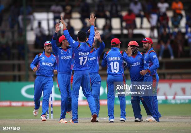 Afghanistan players celebrate the wicket of Shimron Hetmyer of The West Indies during The ICC Cricket World Cup Qualifier Final between The West...