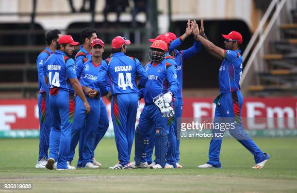 Afghanistan players celebrate the wicket of William Porterfield of Ireland during The ICC Cricket World Cup Qualifier between Ireland and Afghanistan...