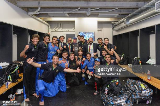 Afghanistan pose for a photo in the dressing room after their win in the ICC U19 Cricket World Cup match between New Zealand and Afghanistan at...