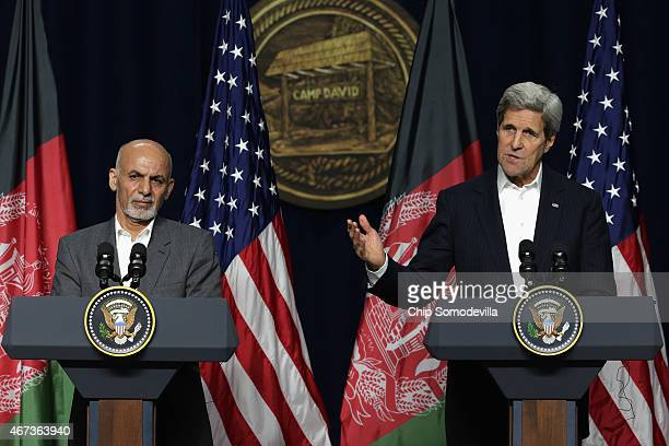 Afghanistan President Ashraf Ghani and U.S. Secretary of State John Kerry hold a news conference after a day of talks at Camp David March 23, 2015 in...