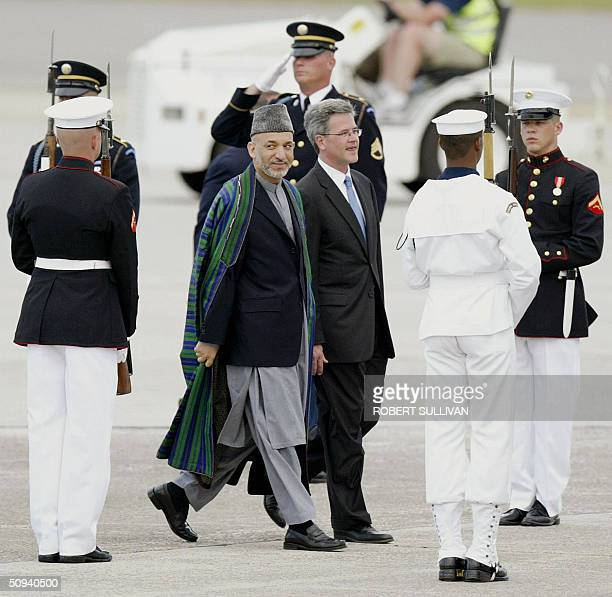 Afghanistan president Hamid Karzai and Deputy US Chief Protocol Officer Jeff Eubank walk through an Honor Guard upon his arrival 08 June 2004 at...