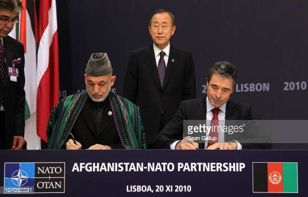 Afghanistan President Hamid Karzai and NATO Secretary General Anders Fogh Rasmussen sign a declaration for the Afghanistan-NATO partnership as United...