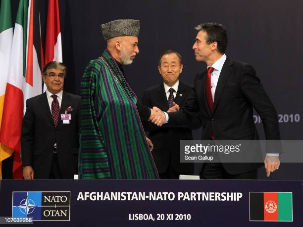 Afghanistan President Hamid Karzai and NATO Secretary General Anders Fogh Rasmussen shake hands after signing a declaration for the Afghanistan-NATO...