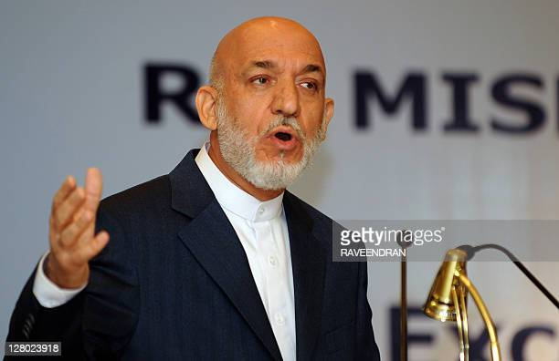 Afghanistan President Hamid Karzai speaks during the RK Mishra Memorial lecture in New Delhi on October 5, 2011. Karzai sought to reassure Pakistan...