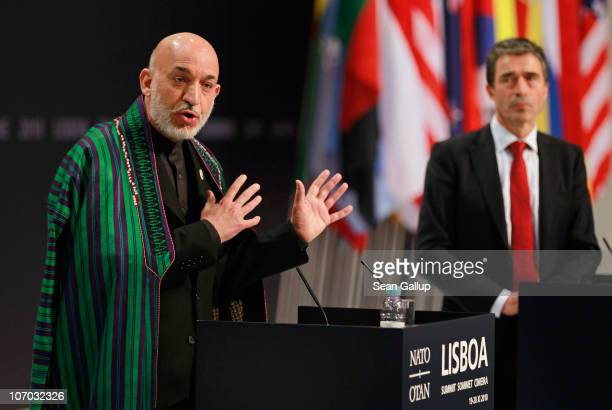 Afghanistan President Hamid Karzai speaks to the media as NATO Secretary General Anders Fogh Rasmussen looks on at the 2010 NATO Summit on November...