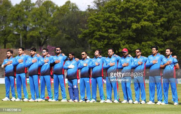 Afghanistan stand for their national anthem during the Summer International between Scotland and Afghanastan at The Grange Club on May 10, 2019 in...