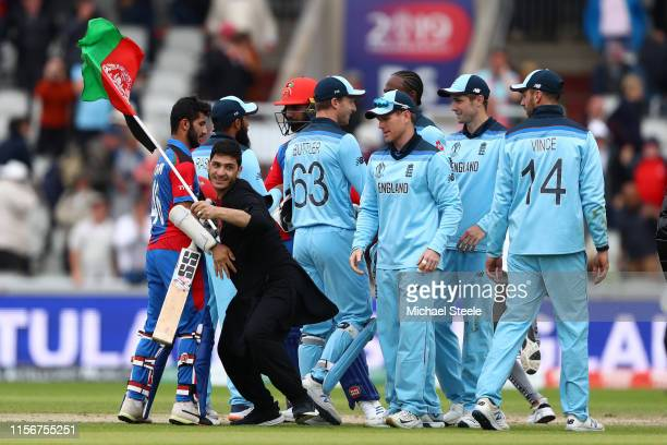 Afghanistan supporter runs on the pitch as Eoin Morgan's England team win by 150 runs during the Group Stage match of the ICC Cricket World Cup 2019...
