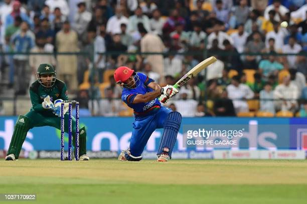 Afghanistan team captain and batsman Mohammad Asghar plays a shot during the one day international Asia Cup cricket match between Pakistan and...