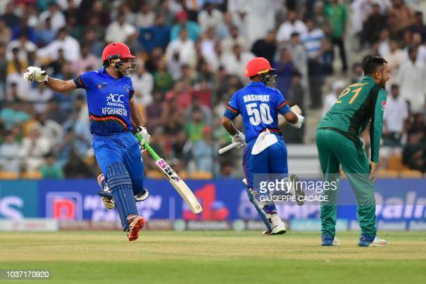 Afghanistan team captain and batsman Mohammad Asghar runs between the wickets during the one day international Asia Cup cricket match between...