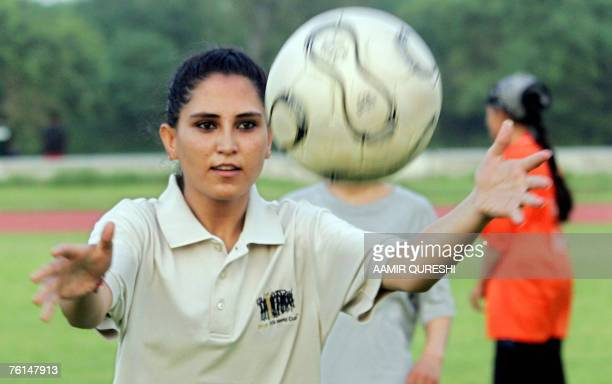 Afghanistan women's football team captain Shamila throws the ball during a training session at the Jinnah Stadium in Islamabad 17 August 2007 The...