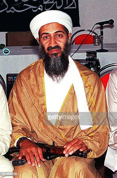 An undated recent file picture shows Osama Bin Laden attending a meeting with a Kalashnikov on his lap in an undisclosed place inside Afghanistan US...