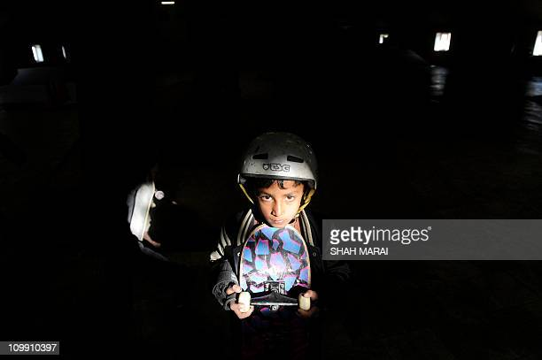 AfghanistanAustraliaunrestsportchildNGO FEATURE by Aymeric VINCENOTPicture taken on February 9 2011 shows a young Afghan skateboarder posing at a...