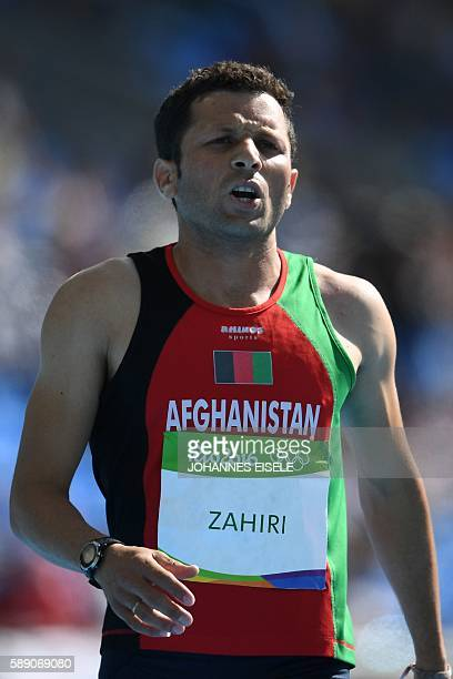 Afghanistan's Abdul Wahab Zahiri competes in the Men's 100m Preliminary Round during the athletics event at the Rio 2016 Olympic Games at the Olympic...