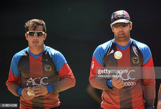 Afghanistan's Amir Hamza and Mohammad Nabi wait to bowl in the nets during a training session at Feroz Shah Kotla cricket ground in New Delhi on...
