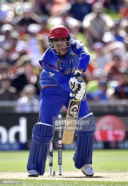 Afghanistan's batsman Usman Ghani plays a shot during the Pool A 2015 Cricket World Cup cricket match between New Zealand and Afghanistan at McLean...