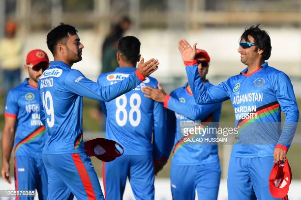 Afghanistan's captain Asghar Afghan celebrates with his teammates after their win during the second T20 cricket match between Afghanistan and Ireland...
