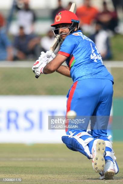 Afghanistan's captain Asghar Afghan plays a shot during the second T20 cricket match between Afghanistan and Ireland in Greater Noida, Uttar Pradesh...