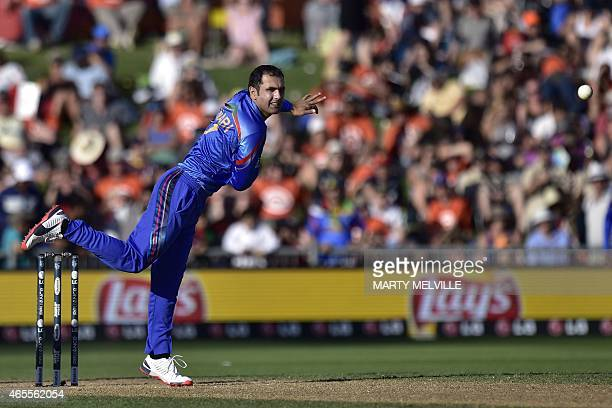 Afghanistan's captain Mohammad Nabi bowls during the Pool A 2015 Cricket World Cup cricket match between New Zealand and Afghanistan at McLean Park...
