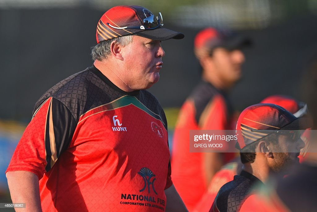 Afghanistan's coach Andy Moles (L) directs players during a final training session ahead of the 2015 Cricket World Cup Pool A match between Australia and Afghanistan in Perth on March 3, 2015. AFP PHOTO / Greg WOOD --IMAGE