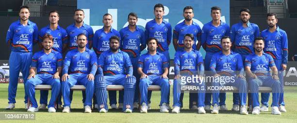 Afghanistan's cricket team poses before the start of the one day international Asia Cup cricket match between Sri Lanka and Afghanistan at the Sheikh...