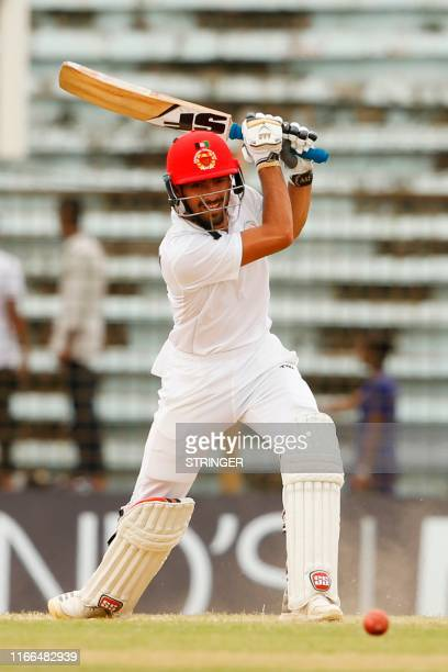 Afghanistan's cricketer Ibrahim Zadran plays a shot during the third day of the one-off cricket Test match between Bangladesh and Afghanistan at the...