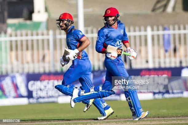 Afghanistan's cricketer Rahmat Shah Zurmatai and Nasir Jamal run between the wickets during the third one day international cricket match between...