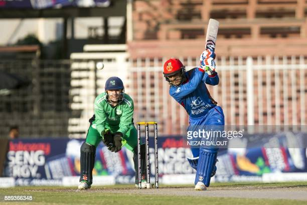 Afghanistan's cricketer Rashid Khan bats during the third one day international cricket match between Afghanistan and Ireland at Sharjah Cricket...