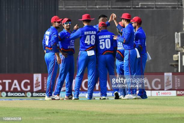 Afghanistan's cricketers celebrates after the dismissal of Bangladesh batsman Mohammed Mithun during the one day international Asia Cup cricket match...