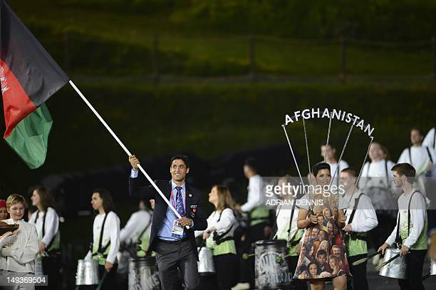 Afghanistan's flagbearer Nesar Ahmad Bahawi walks ahead of his delegation during the opening ceremony of the London 2012 Olympic Games on July 27...