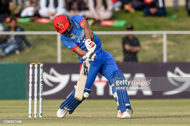 Afghanistan's Gulbadin Naib plays a shot during the third T20 between Afghanistan and Ireland in Greater Noida on March 10, 2020.