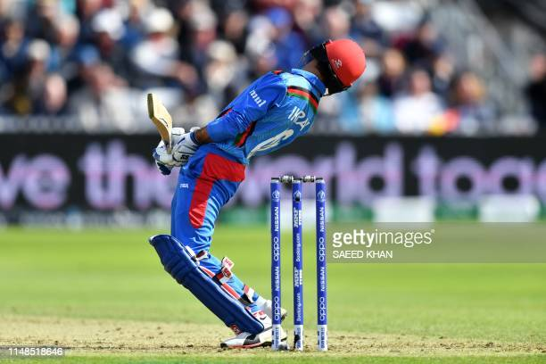 Afghanistan's Ikram Alikhil bats during the 2019 Cricket World Cup group stage match between Afghanistan and New Zealand at The County Ground in...